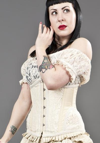 Top only; does not include corset
