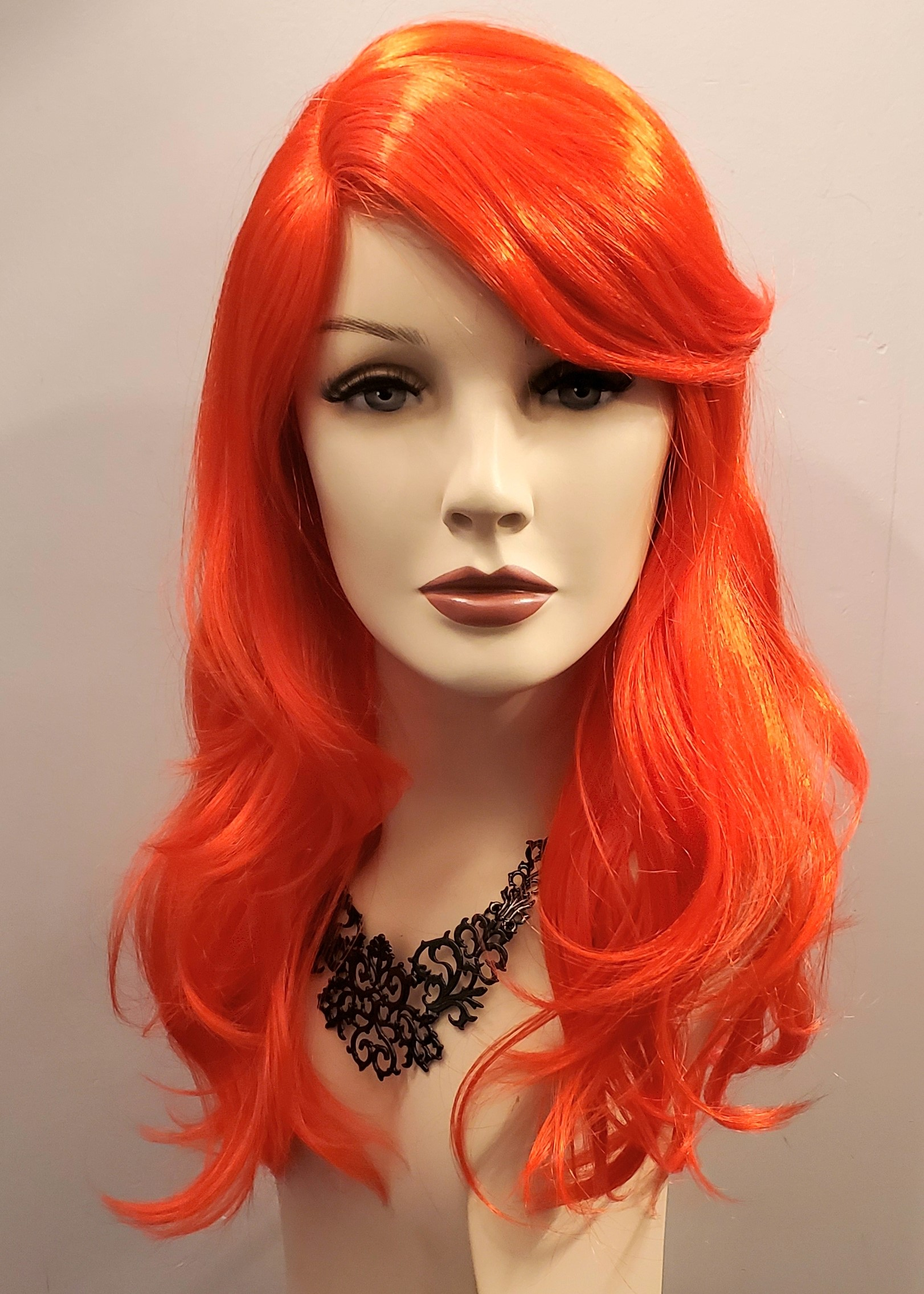 Mid-length wig features a natural part 0382 Edmonton